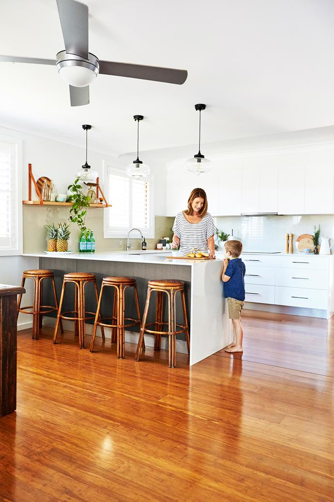 """Anna and Aaron created the """"glass-look"""" splashback using tiles, and made the leather strap shelf. They found the stools on Gumtree for $50."""
