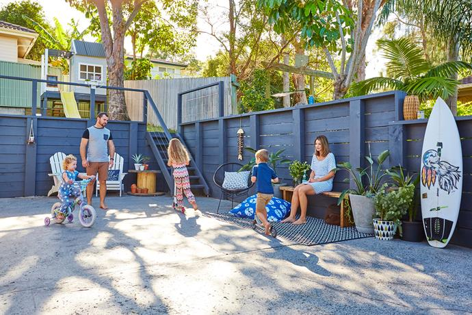 """""""Out the back, we put railing and stairs down to the lower levels, painted the retaining wall and polished the concrete courtyard,"""" says Anna."""
