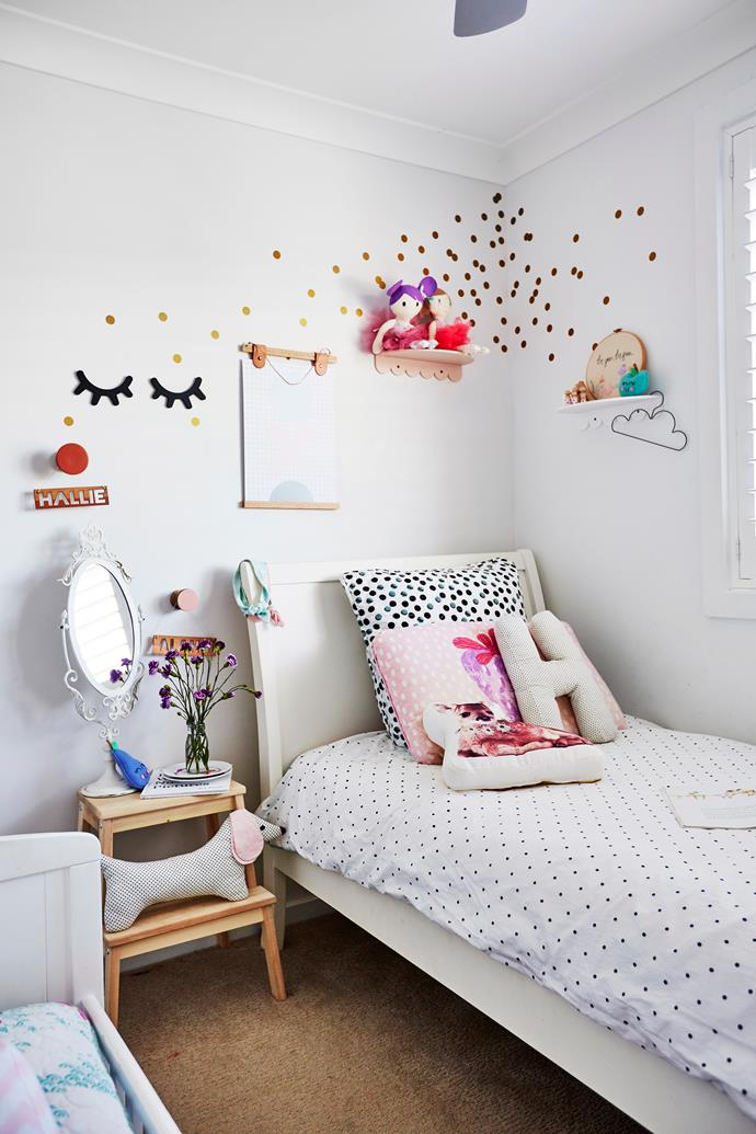 Anna's daughters share a delightful bedroom, a haven for little girls.
