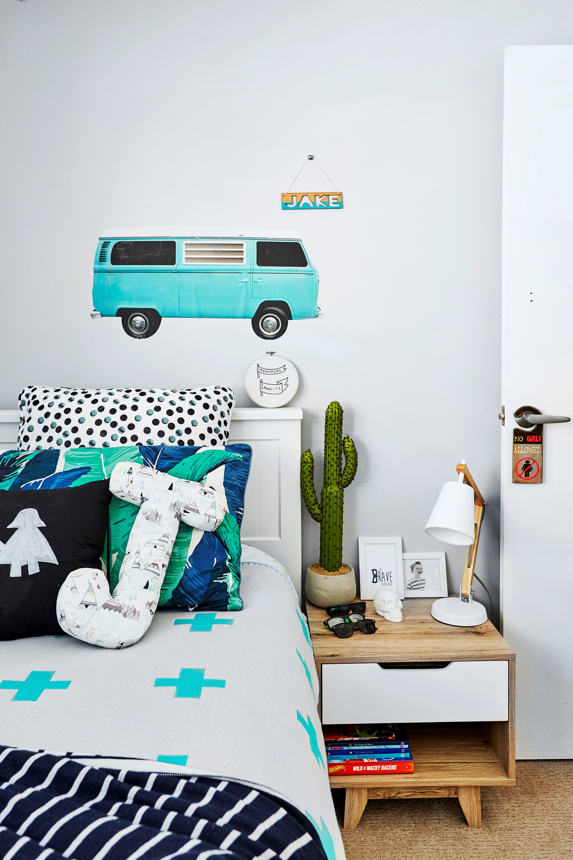 Wall decals, like this campervan Kombi, are a fun update and can be easily removed as your child grows older. Photo: Andrew Finlayson