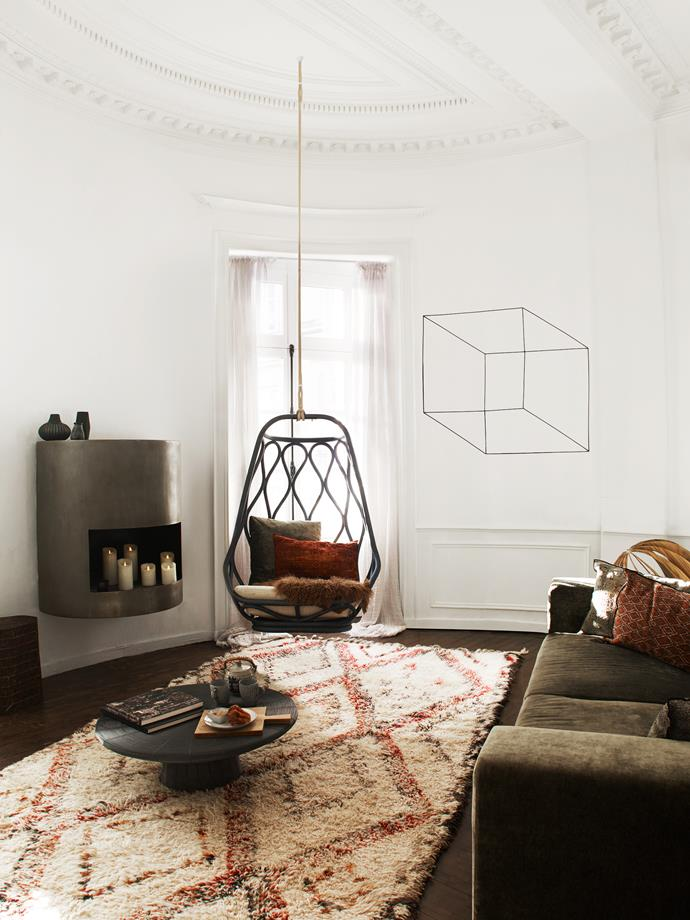 A handmade Beni Ourain rug defines the living area. Wire sculpture by Antonino Sciortino.