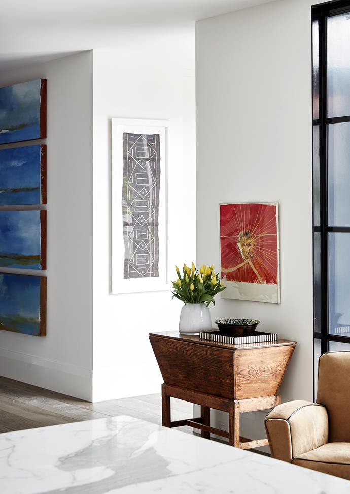 Room to create a walk-through gallery space for the family's art collection was part of the brief. Quartet of works by Luc Leestemaker. A Brett Whiteley work hangs above an Irish baker's bin bought in London.