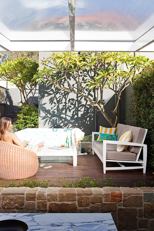 A comfortable outdoor setting in a shady spot acts like an extension of the indoors in this Bondi Beach home.