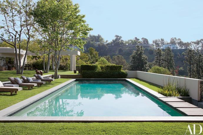 """Ellen DeGeneres & Portia de Rossi are well known for their fantastic interior decorating taste. It appears this talent extends to the outdoors with this stunning pool in their Californian home, bordered by Brazilian-granite and perfectly manicured lawns. Image via [Architectural Digest](http://www.architecturaldigest.com/