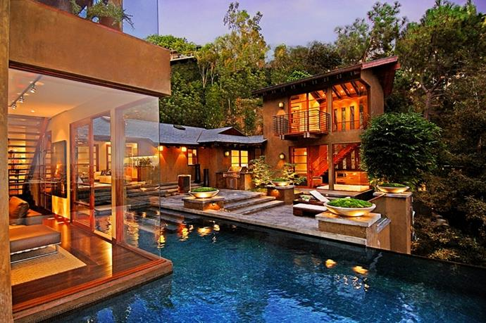 World-famous Scottish DJ, Calvin Harris recently purchased this $7M sprawling home in Hollywood Hills. With a pool that rivals the size of the home, we can only imagine the summer pool parties.