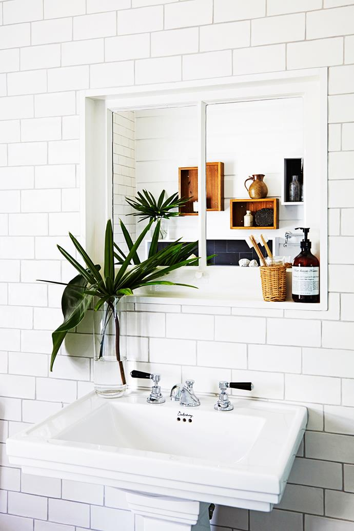 **Think outside the box.** Innovation and ingenuity are the two pillars to a successful sustainable space. This pedestal basin was bought at a builder's yard and re-enamelled, whilst an old window frame was turned into a recessed mirror. Clever! *Photography: Emma Reilly / bauersyndication.com.au*