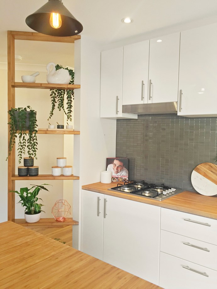A dividing wall helps to define the area and provides attractive open storage and display.