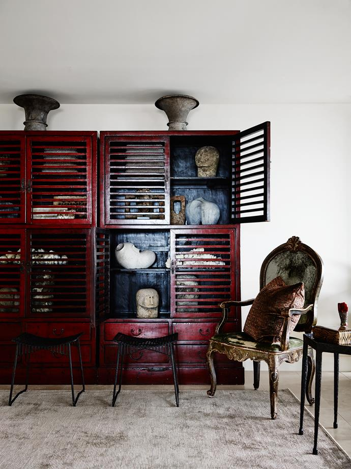 """Thomas purchased a pair of Chinese cabinets at auction, certain he'd use them for display. """"You need a focal point in each room, typically with some height to it, and these give instant architecture to our entry hall,"""" he says."""