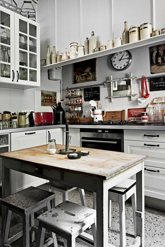 New cabinetry contrasts with secondhand pieces in the small kitchen, large enough for a table and stools.