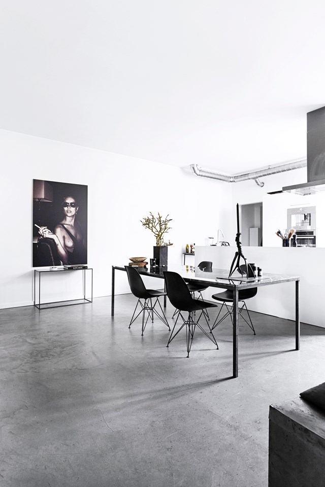 "The monochrome palette, minimal modern furniture and an array of greys leave no doubt that this apartment is home to a stylish creature. Ingeborg Wolf is indeed a fashion stylist and her [Copenhagen apartment](https://www.homestolove.com.au/a-showroom-transformed-into-a-chic-apartment-4281|target=""_blank""), funnily enough, was formerly a clothing showroom. *Photo:* Birgitta Wolfgang Drejer / Sisters Agency"