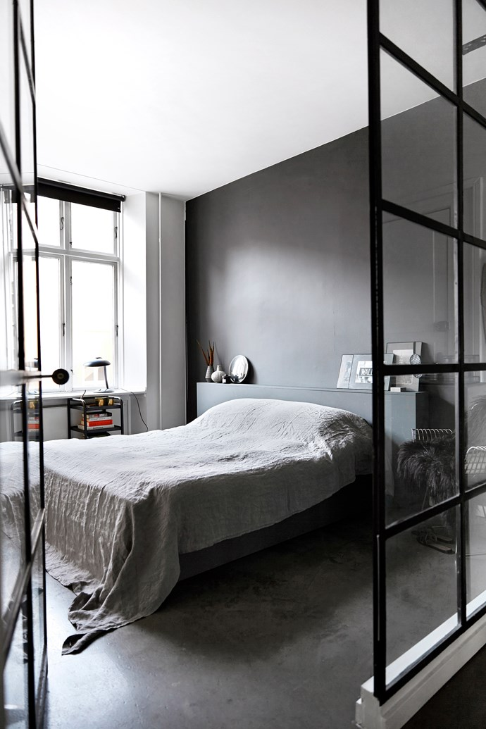 Unable to find a textural linen bedspread in a grey that worked with the charcoal wall, Ingeborg has used an extra-large tablecloth instead. No need to iron, either!
