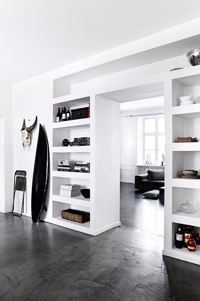 """A clever use of room dividers, built-in storage and a fresh monochrome palette have transformed this [former fashion showroom](https://www.homestolove.com.au/a-showroom-transformed-into-a-chic-apartment-4281