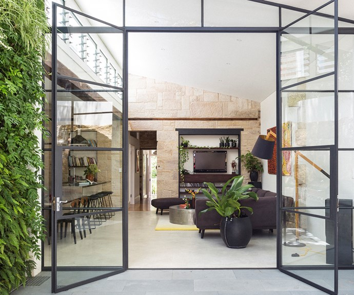 "The major contributor to the new sense of space and light in the living area is without doubt the 4.5m-high steel-framed windows. They were also a major expense due to the material and height – but they were ""worth every cent"", say Holly and Alastair."