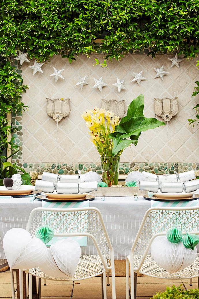 Use a tablecloth to add a sense of occasion to your Christmas backyard party.