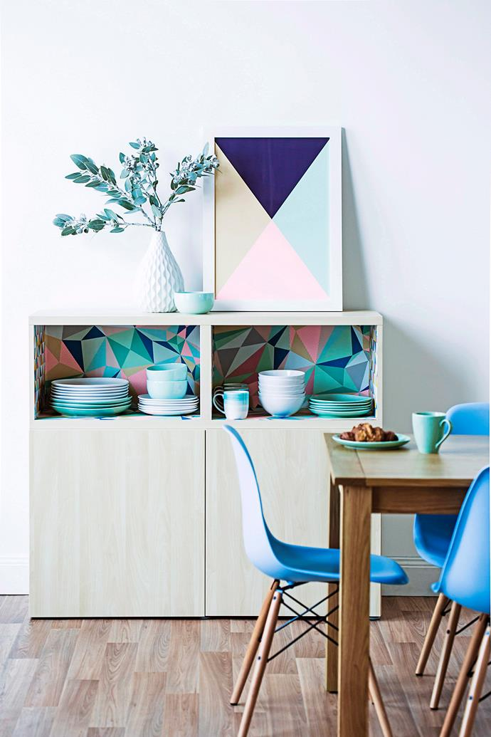 Colourful  wallpaper and a matching artwork make this cupboard an eye-catching focal point. Photo: bauersyndication.com.au