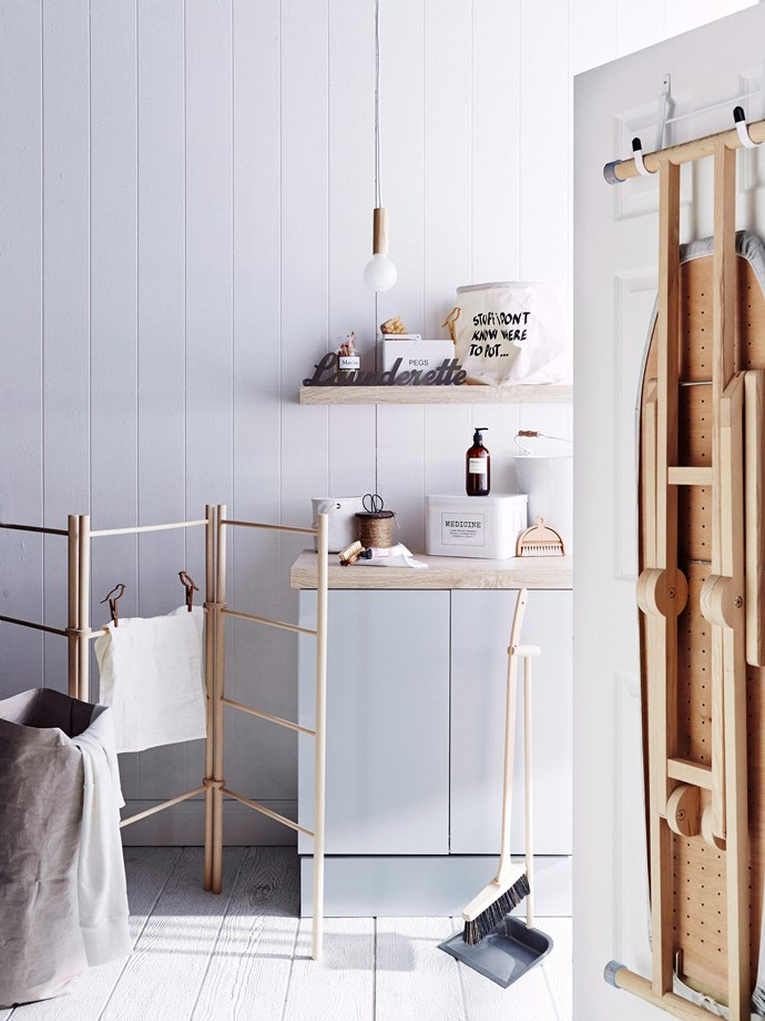 **Added extras:** if your laundry is a little lacklustre and there is not much you can do about it, go all out with accessories! A timber drying rack, designer detergent and cute storage baskets will instantly give the space a boost. *Photo: Brett Stevens / bauersydndication.com.au*