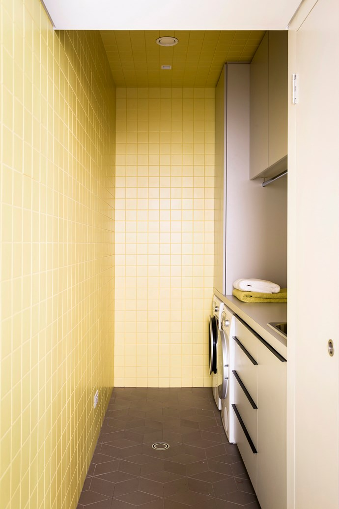 **Be bold, be brave:** the laundry is a place for mundane housework yes, but it doesn't have to *look* mundane. Painting or tiling the room in a cheerful shade of yellow is bound to put a smile on your dial. *Photo: Chris Warnes / bauersydndication.com.au*