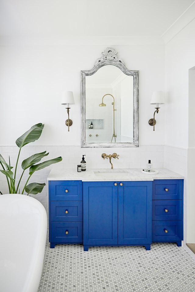 "Complete with Carrara and Thassos mosaic floor tiles; this [modern, yet classic ensuite](https://www.homestolove.com.au/luxury-modern-bathrooms-4329|target=""_blank"") was created to feel like a living space and not just a bathroom. Although the bathroom is completely new, antique brass fixtures and a distressed mirror frame make this space feel as though it's been there forever. *Photo: Rhys/Jones Interior Architecture / Story: Belle*"