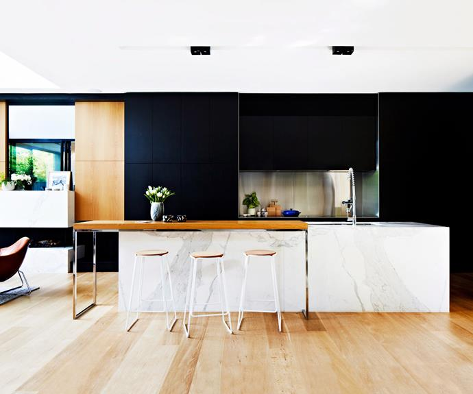 "Dark cabinetry acts as a dramatic backdrop for a statement marble [kitchen island](https://www.homestolove.com.au/8-kitchen-islands-to-inspire-your-next-kitchen-renovation-5686|target=""_blank"")."