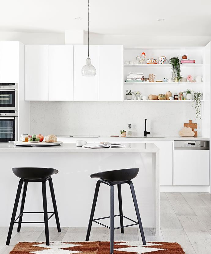 "Playful pastel-hued touches add personality to an otherwise all-[white kitchen](https://www.homestolove.com.au/white-kitchen-design-with-warmth-5321|target=""_blank"")."