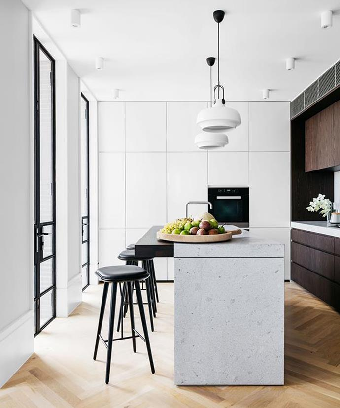 Create texture in an otherwise monochromatic space with materials such as marble and wood, or with a contrast in the direction of floorboard or tile arrangement.
