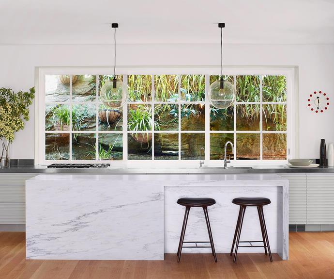 Use a lush outlook to your advantage by bringing exterior garden features into the kitchen via a window place of a splashback.