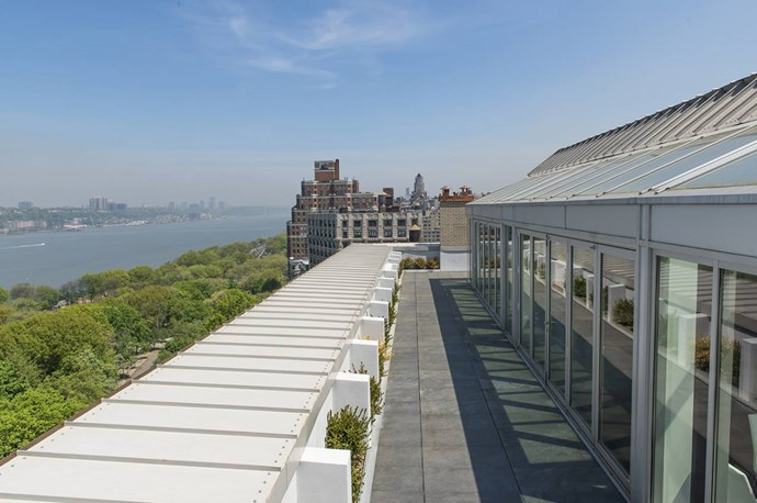 A wrap around terrace offers panoramic views of the city skyline and Hudson River. Photo via [Spivak Architects](http://www.spivakarchitects.com/).
