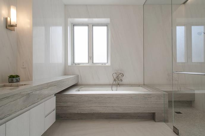 The master ensuite exudes luxury with its huge swathes of marble. Photo via [Spivak Architects](http://www.spivakarchitects.com/).