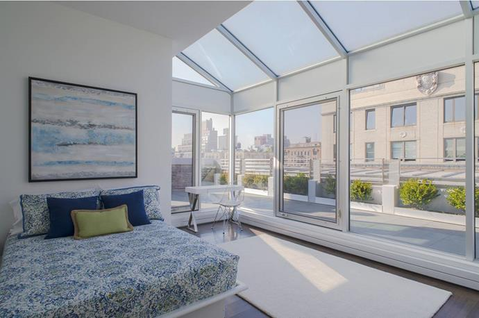 Operable glass walls on three-sides flood the penthouse with natural light. Photo via [Spivak Architects](http://www.spivakarchitects.com/).