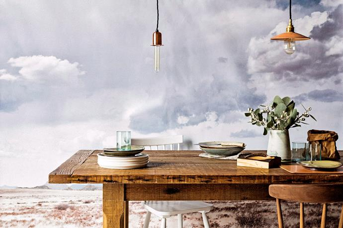 Of course, a solid farm-style table and classic chairs can be the base of any rustic look, but there's no reason why you can't add modern elements. An exposed elongated lightbulb with a copper stem helps to blend new and old worlds perfectly. *Photo: Felix Forest / bauersyndication.com.au*