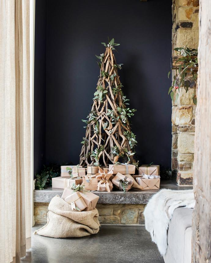 "Natural foliage from the bush that surrounds this [stone cottage in country Victoria](http://www.homestolove.com.au/tim-and-joannes-rustic-stone-cottage-2533|target=""_blank"") has been used to decorate this driftwood Christmas tree. *Photo: Nikole Ramsay*"