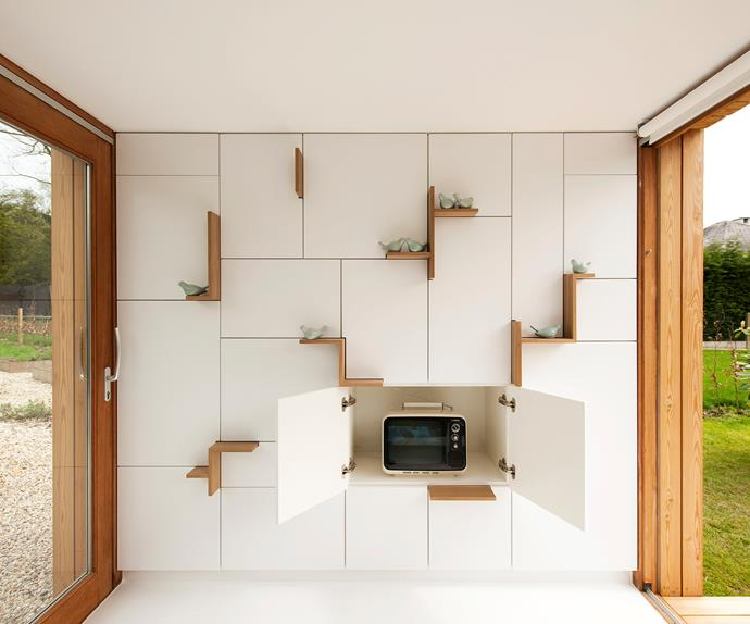 Filip designed the storage wall to be as aesthetically pleasing as it is practical. It houses his desk and office  as well as other items such as a TV and a small heater.