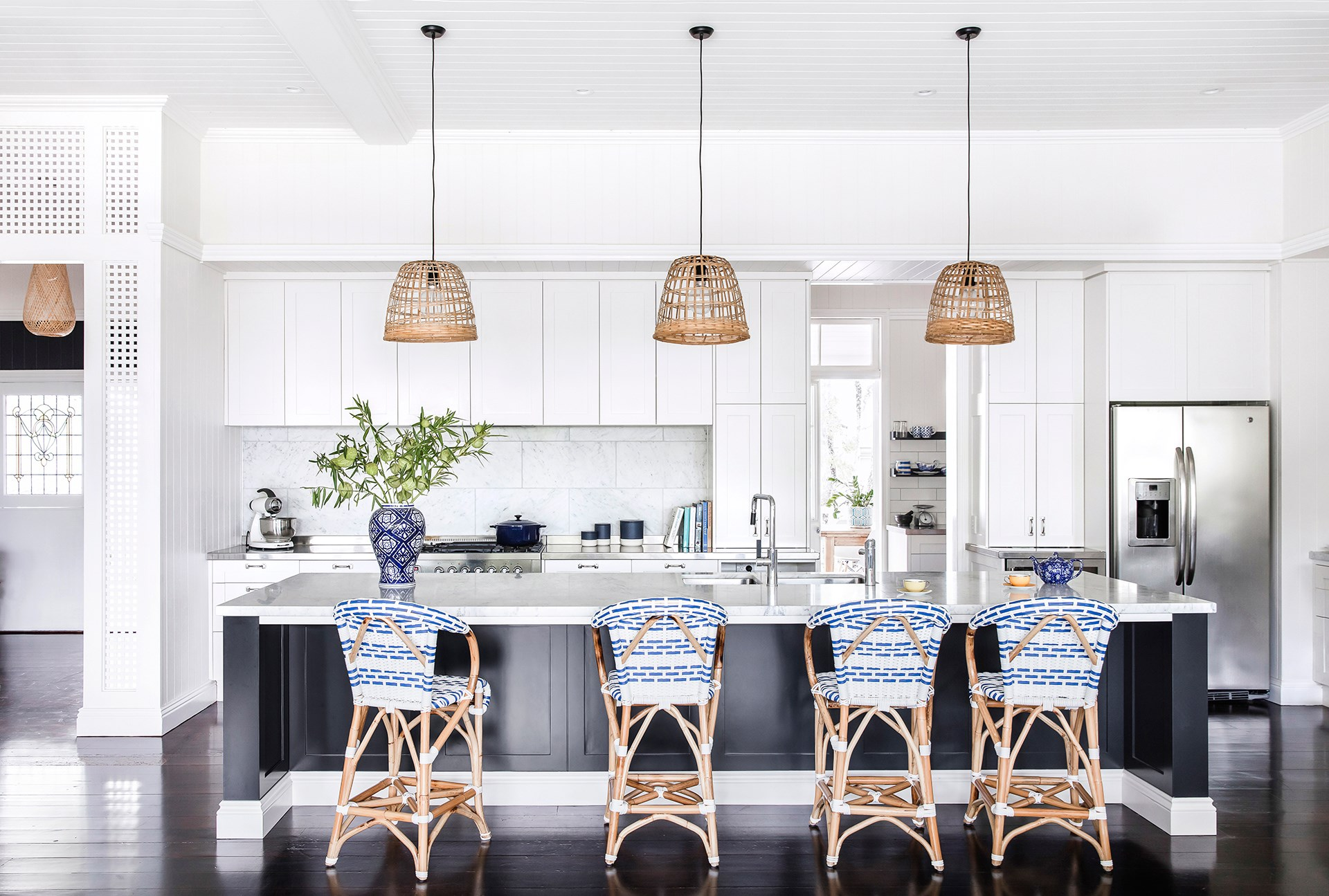 The classic lines of this Hamptons-style kitchen within a [refreshed 1920s Queenslander](http://www.homestolove.com.au/a-refreshed-1920s-queenslander-4363) are softened with the addition of cane and wicker, which adds a summery, comfortable feel. *Photo: Maree Homer*