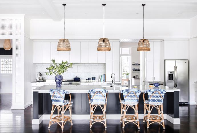 """The focal point of the cooking zone is the [Carrara marble-topped](http://www.homestolove.com.au/how-to-care-for-marble-benchtops-3745