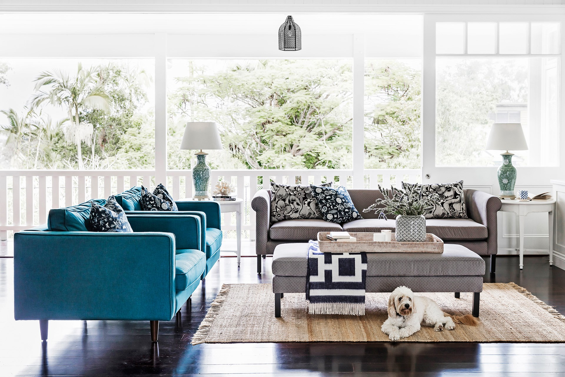 The airy living room in this [refreshed 1920s Queenslander](http://www.homestolove.com.au/a-refreshed-1920s-queenslander-4363) exudes a seaside holiday vibe with its free-flowing design and Hamptons style decor. Photo: Maree Homer / Australian House & Garden