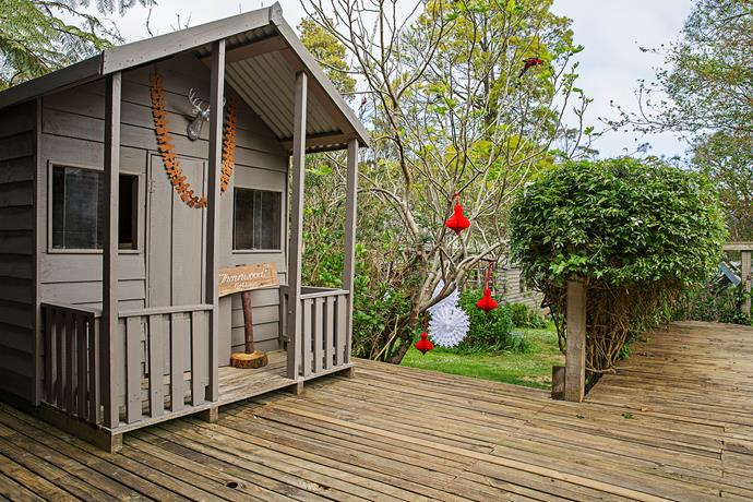 Even the trees and cubby house outside get the festive treatment.