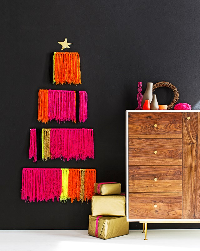 "**Shaggy Christmas tree:** Create a shaggy wall-hung tree out of neon-bright wool and a few pieces of dowel. To make even bunches of wool, wrap around your forearm from fist to elbow 12 times, then cut bottom of wool for a ""shaggy"" effect (you'll need to repeat this process until you have enough bunches to cover the dowel). All you need to do is tie the bunches of wool in colour blocks to the dowel pieces then hang each section to your wall using screw hooks. It's bright and striking and there'll be plenty of floor space left for pressies!"