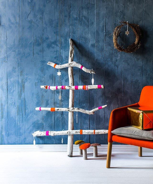 **Driftwood Christmas tree:** Nothing says Christmas in Australia like sipping sparkling wine with sand between your toes. That and a beachy driftwood tree. Simply comb your local beach for driftwood (you can also buy driftwood online). Spray-paint each piece white then use a drill and long screws to secure horizontal pieces to one long vertical piece. Decorate with bright-coloured wool and adorn with a few beach-inspired baubles.