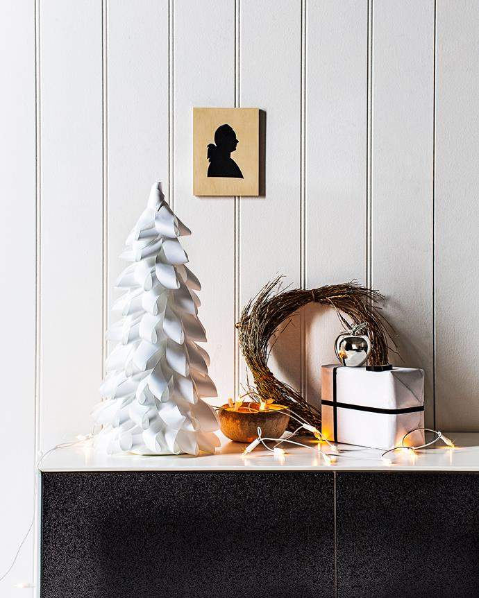"""Tree cost, $42.38: Grosgrain ribbon in White (38mm), from $1.50 a m, [Vandoros Fine Packaging](http://www.vandoros.com.au/ target=""""_blank"""" rel=""""nofollow""""). Decofoam cone (55cm), $10.99, and Dressmaking pins (32mm), $1.39 for pack of 100, [Lincraft](https://www.lincraft.com.au/ target=""""_blank"""" rel=""""nofollow"""")."""
