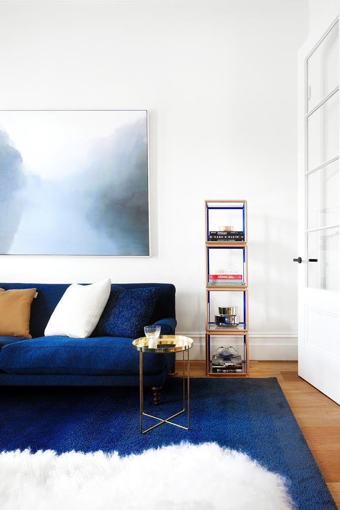 """The heritage shell of the room has been layered with an electric Yves Klein blue rug and SCP 'Oscar' sofa from [Hub](http://hubfurniture.com.au/