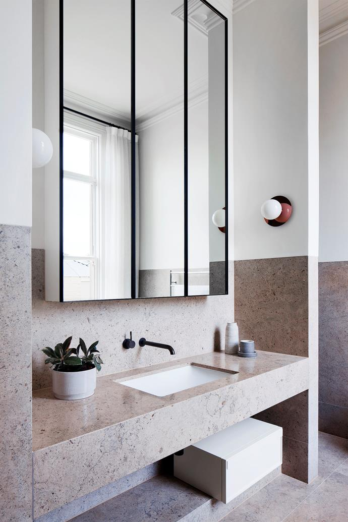 """A custom mirror in the main ensuite and a wall light in antique bronze by [Izé](http://www.ize.info/