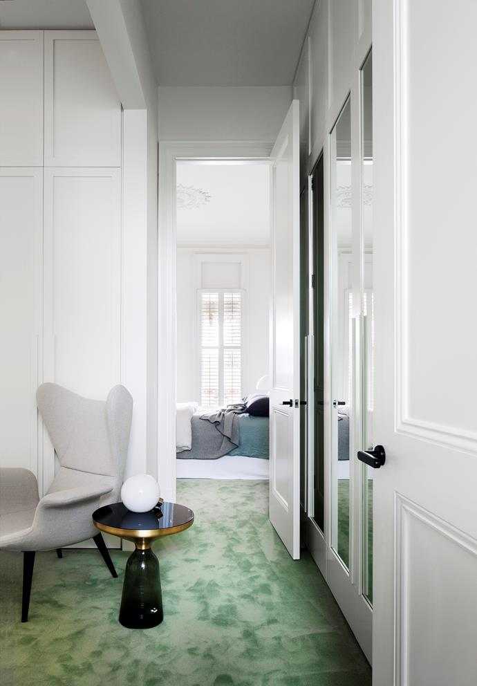The luxurious main bedroom rests on the landing of the first set of stairs.