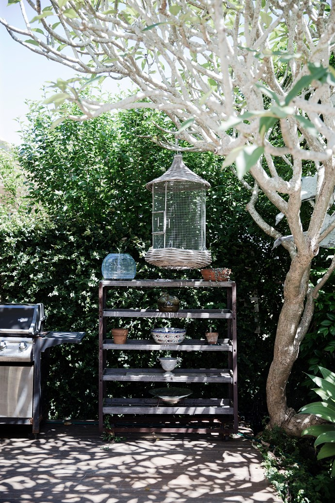 Eclectic found objects are dotted around the garden adding character and decoration.
