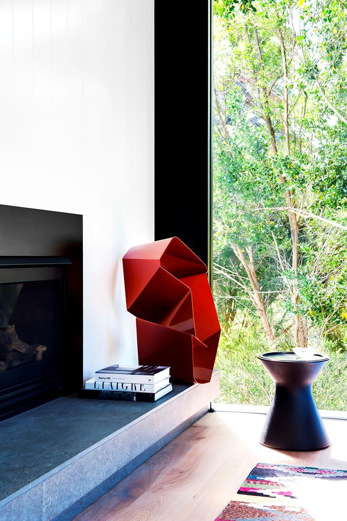 Sunburnt Country sculpture by Piers Buxton, is displayed on the fireplace's floating stone platform.