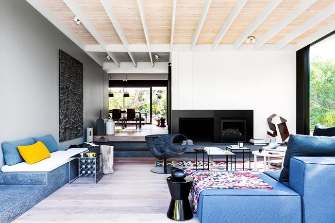 """Textured stone platforms in the living room, reminiscent of volcanic stone found on nearby beaches, act as informal seating. Limited-edition woven dining chairs, prismatic cubed side tables and the 'Smock' armchair by [Patricia Urquiola](http://www.patriciaurquiola.com/