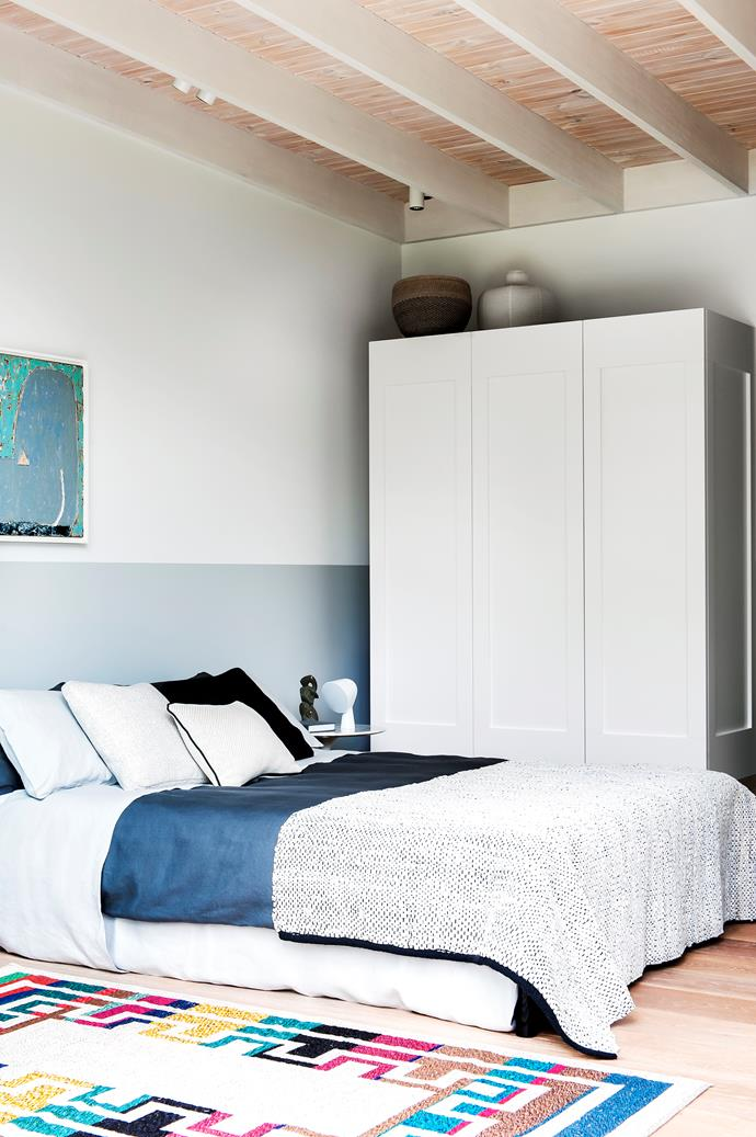 The bespoke wardrobe was custom designed by Ljiljana. The Belgian linen duvet and knitted leather throw add a soft touch, while the handwoven rug bought in Calabria, injects colour.