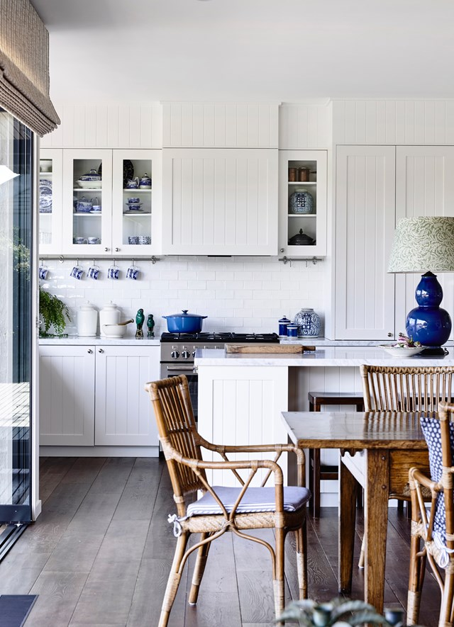 "The white kitchen within this [Mornington Peninsula getaway](http://www.homestolove.com.au/10-steps-to-coastal-style-4398|target=""_blank"") could be very dull indeed, but the diverse materials – subways tiles, tongue-and-groove doors – pique visual interest. *Photograph*: Derek Swalwell"
