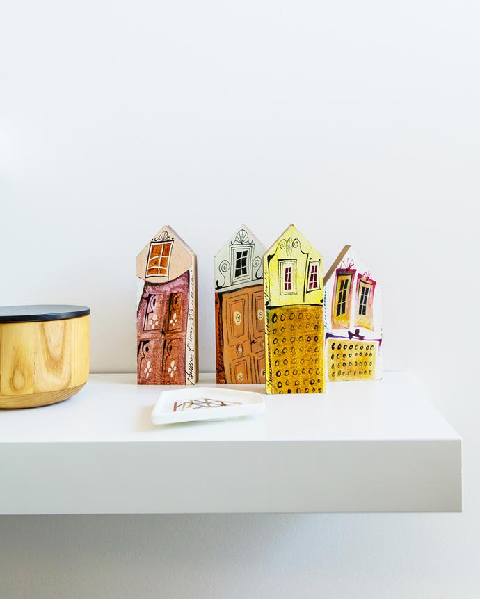 Little wooden houses bought on holiday in Amsterdam decorate the study.