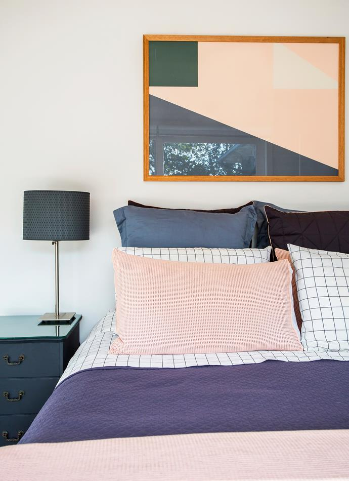 The furniture, bedlinen and artwork all share the same colour palette, giving the room a cohesive feel.