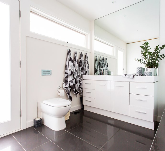 A grand scale mirror adds to the feeling of roominess in the family bathroom.